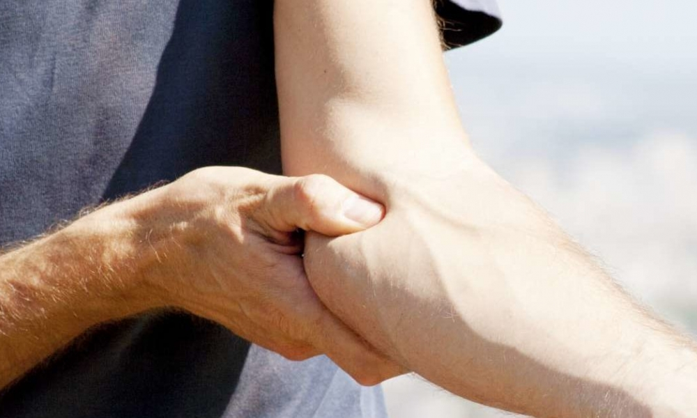 inner elbow pain from lifting weights.